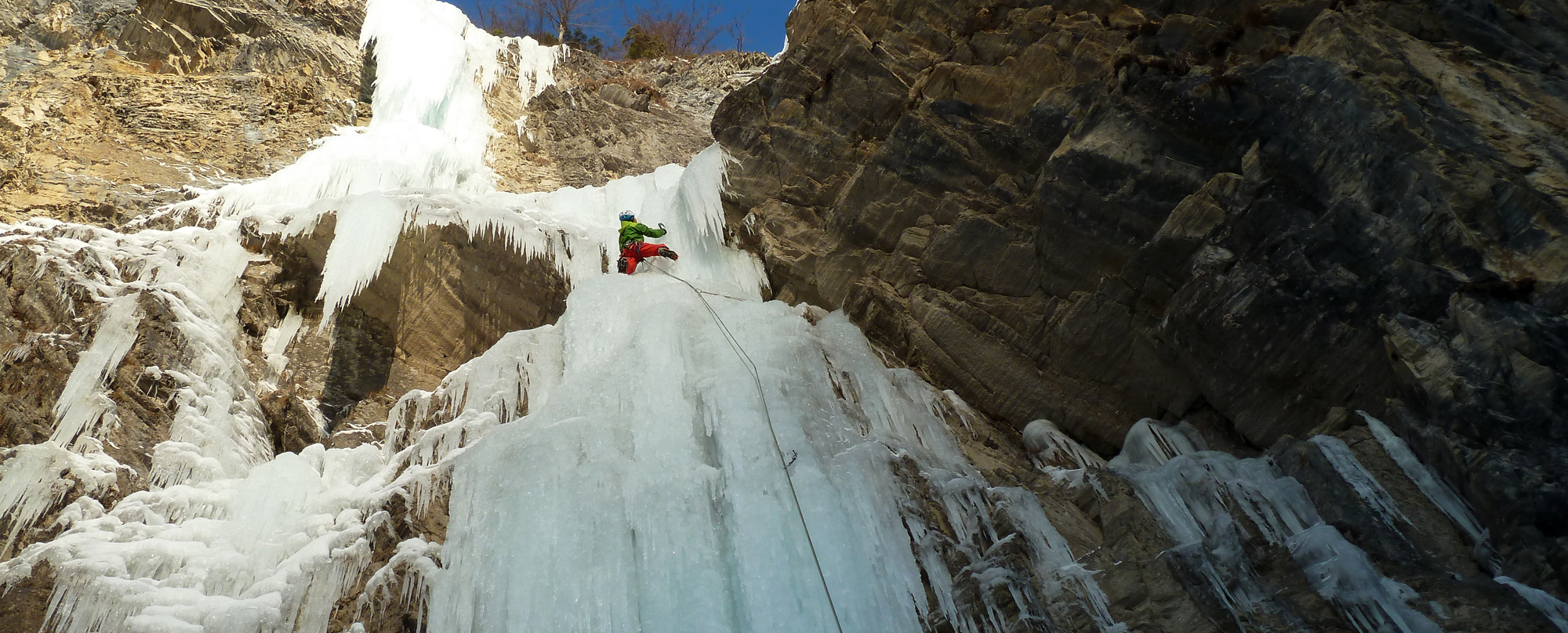 Ice climbing on icy waterfalls in Gastein valley.